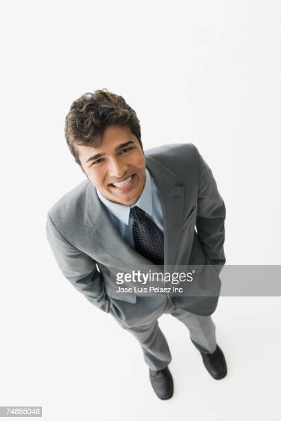 Indian businessman with hands in pockets