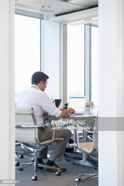 Indian businessman working at conference table