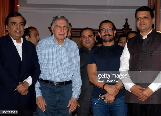 Indian businessmen Mukesh Ambani Ratan Tata Bollywood actor Aamir Khan and Chief Minister of Maharashtra Devendra Fadnavis pose for a photograph...