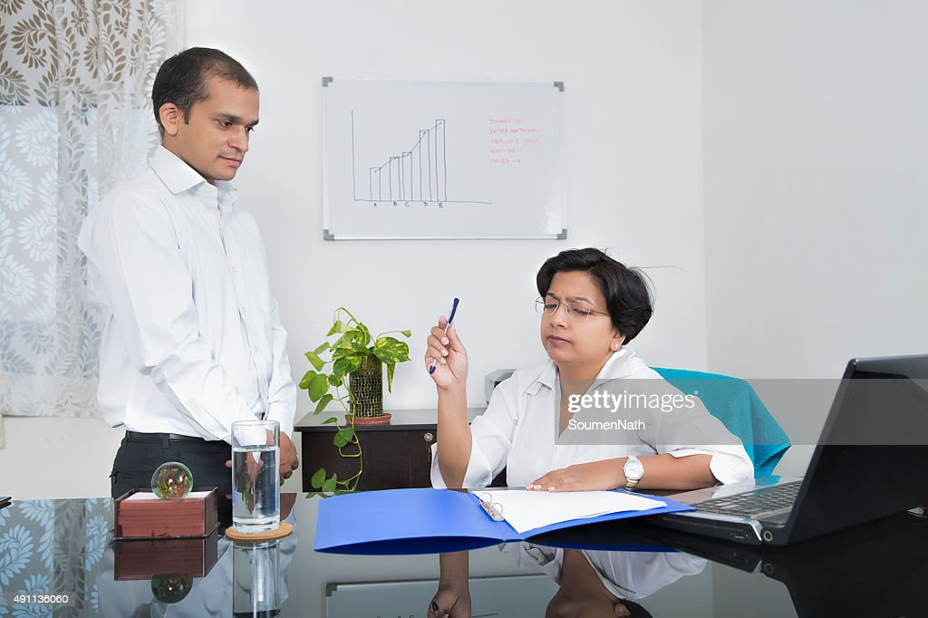 Indian Businesswoman  annoyed with her employee : Stock Photo