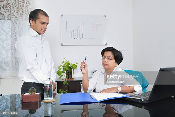 Indian Businesswoman  annoyed with her employee