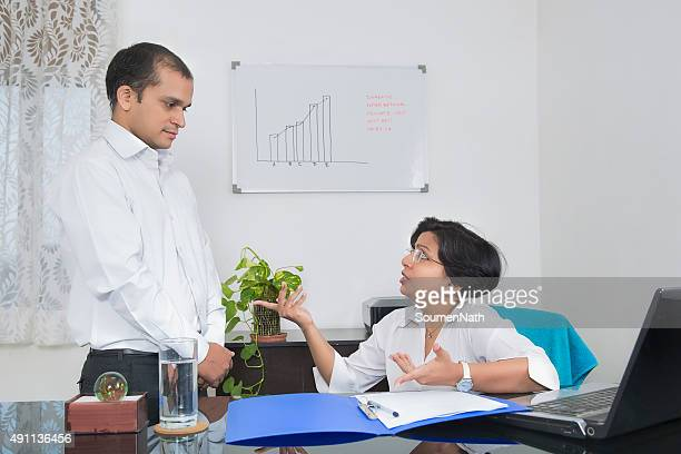 indian businesswoman  annoyed with her employee - bossy stock pictures, royalty-free photos & images
