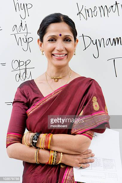 indian businesswoman in front of whiteboard - indian subcontinent ethnicity stock pictures, royalty-free photos & images