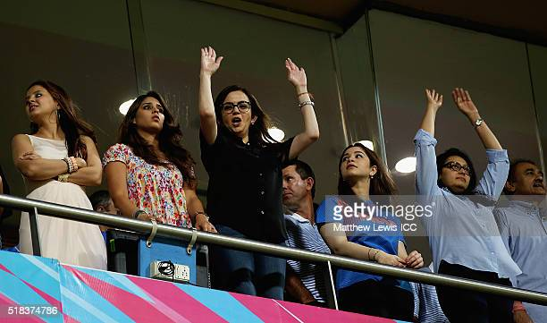Indian businesswoman Nita Ambani joins in with a 'Mexican wave' during the ICC World Twenty20 India 2016 SemiFinal match between West Indies and...