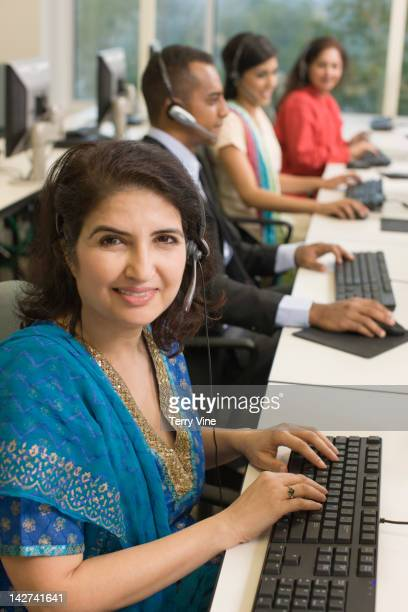 Indian businesswoman using computer in office
