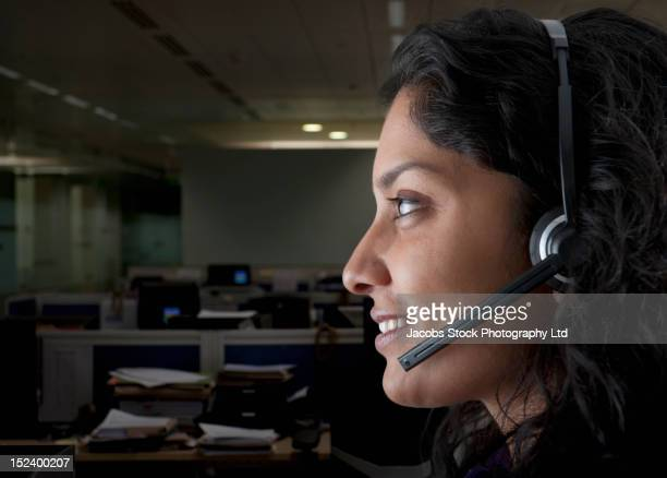 Indian businesswoman working in call center