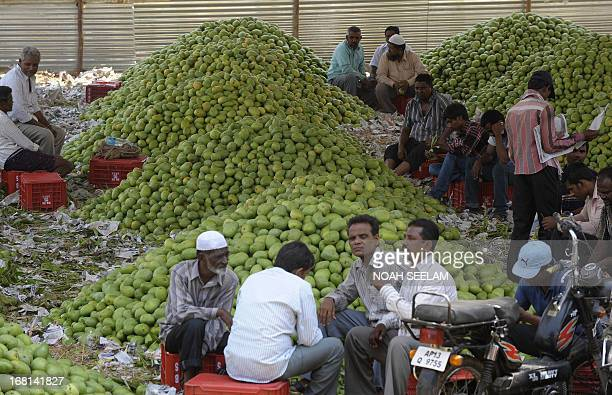 Indian buyers wait for the auction of mangoes at the Gaddiannaram Fruit Market on the outskirts of Hyderabad on May 6 2013 The ruling Indian...