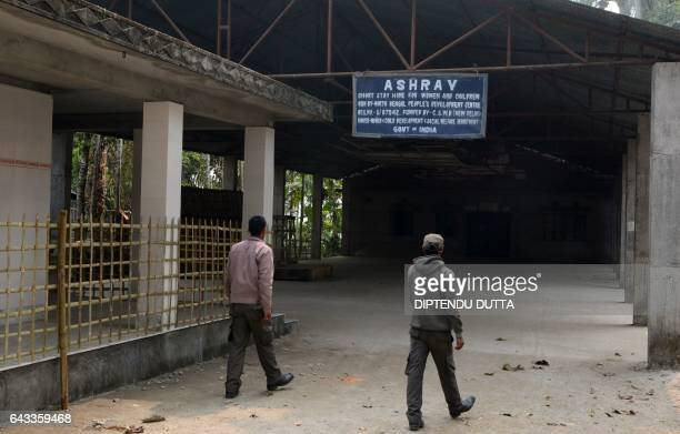 Indian bystanders walk near the entrance of the Ashray Home in Jalpaiguri on February 21 which is at the centre of an alleged child trafficking...