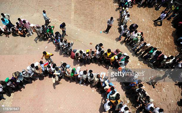 Indian candidates at a post Office line up for to get a copy of a police recruitment application in Allahabad on July 18 2013 The Indian postal will...