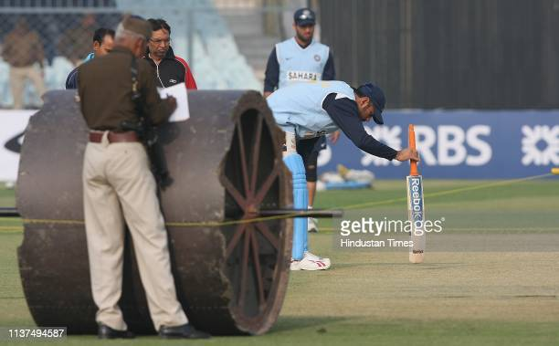 Indian captain MS Dhoni and batsman Yuvraj Singh inspecting the pitch ahead of the third ODI between India and England on November 19 2008 in Kanpur...