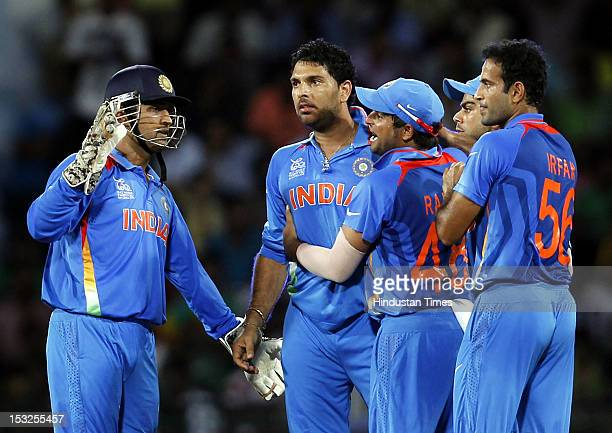 Indian Captain MS Dhoni and Yuvraj SinghVirat Kohli and Suresh Raina celebrate after the dismissal of Captain AB de Villiers during the ICC T20 World...