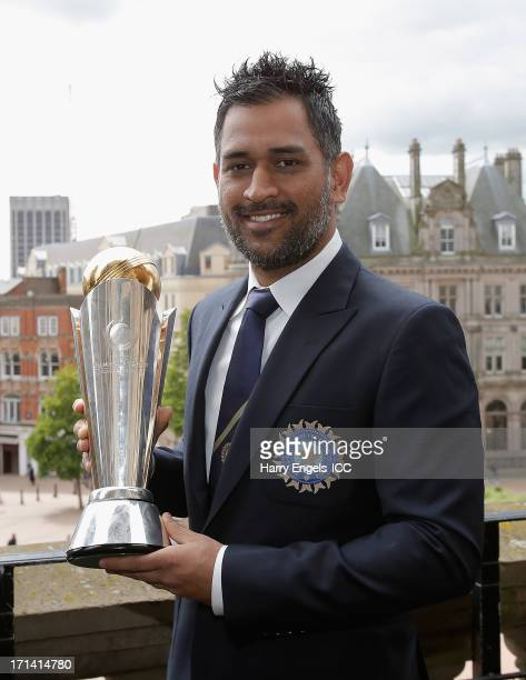 Indian captain MS Dhoni poses with the Champions Tophy during a photocall for the winners of the ICC Champions Trophy on June 24 2013 in Birmingham...