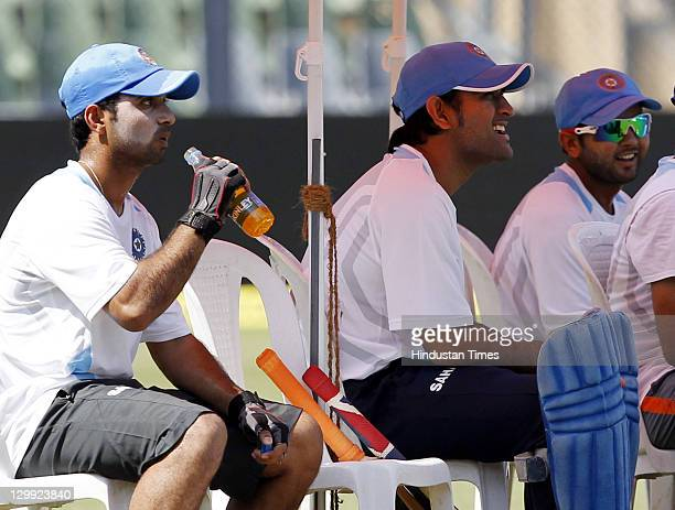 Indian captain MS Dhoni with Ajinkya Rahane and Parthiv Patel during the practice session on the eve of their 4th ODI against England at Wankhede...