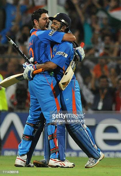 Indian captain Mahendra Singh Dhoni and teammate Yuvraj Singh reacts after winning against Sri Lanka during the Cricket World Cup 2011 final at The...