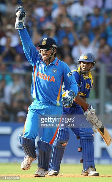 Indian captain Mahendra Singh Dhoni appeals after taking a catch off Sri Lankan batsman Thilan Samaraweera during the ICC Cricket World Cup final...