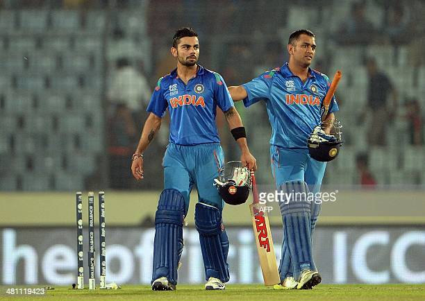 Indian captain Mahendra Singh Dhoni greets teammate Virat Kohli after winning the match against Bangladesh during the ICC World Twenty20 tournament...