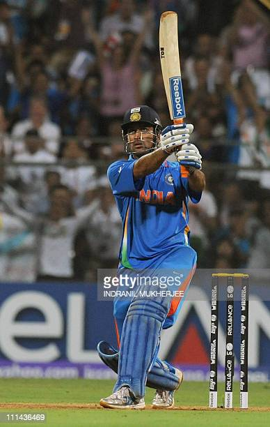 Indian captain Mahendra Singh Dhoni hits a six to win against Sri Lanka during the Cricket World Cup 2011 final at The Wankhede Stadium in Mumbai on...