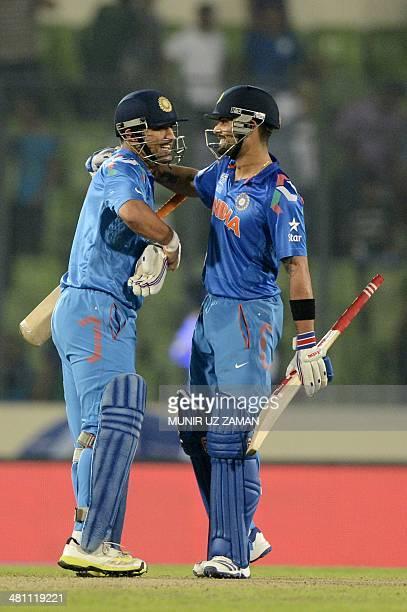 Indian captain Mahendra Singh Dhoni hugs teammate Virat Kohli as they celebrate victory over Bangladesh during the ICC World Twenty20 tournament...