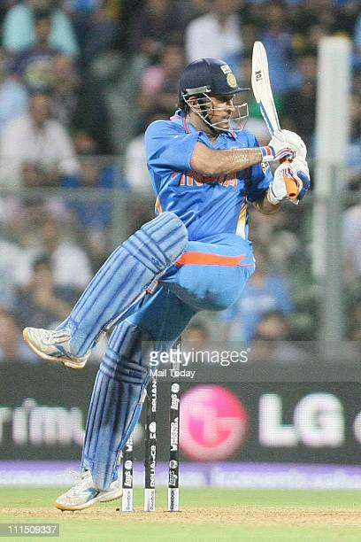 Indian Captain Mahendra Singh Dhoni in action during the ICC Cricket World Cup 2011 Final match at The Wankhede Stadium in Mumbai on April 2, 2011....