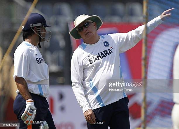 Indian captain Mahendra Singh Dhoni takes some batting tips from coach Duncan Fletcher during the practice session on the eve of their 4th ODI...