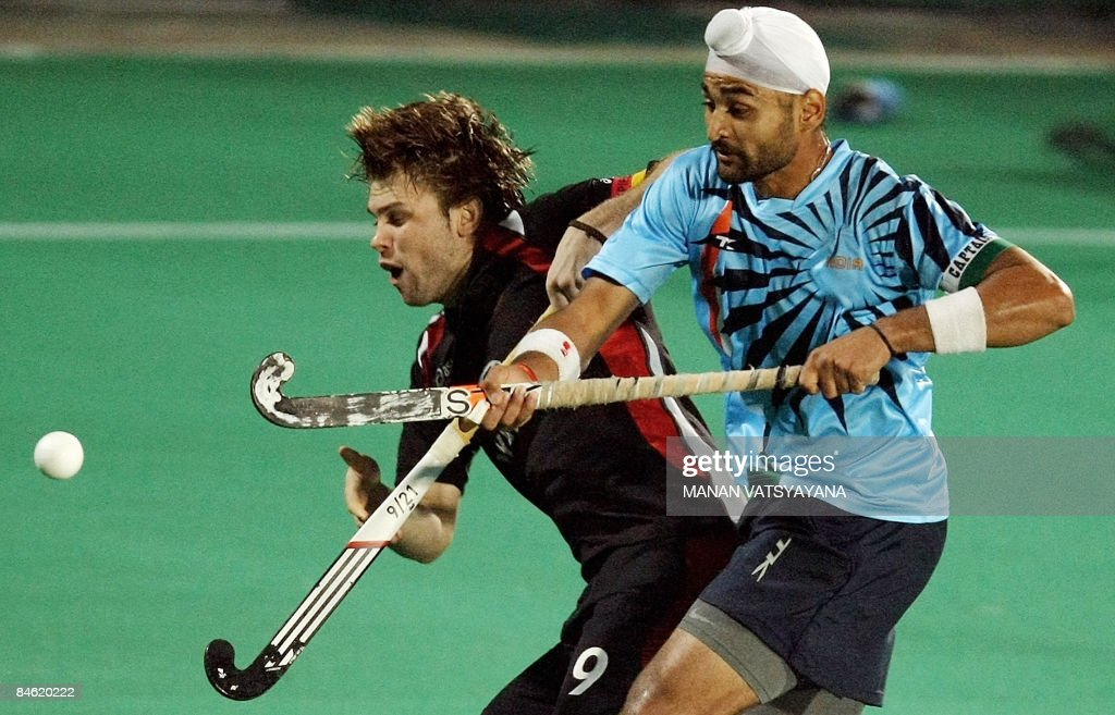 Indian captain Sandeep Singh vies for the ball with Germany`s Moritz Furste during the fournation Punjab Gold Cup in Chandigarh on February 3 2009 At.