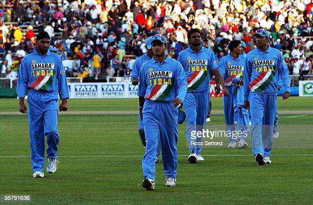 Indian captain Sourav Ganguly, centre leads a despondent side from the pitch after the five wicket loss to the New Zealand Black Capsin the third one...