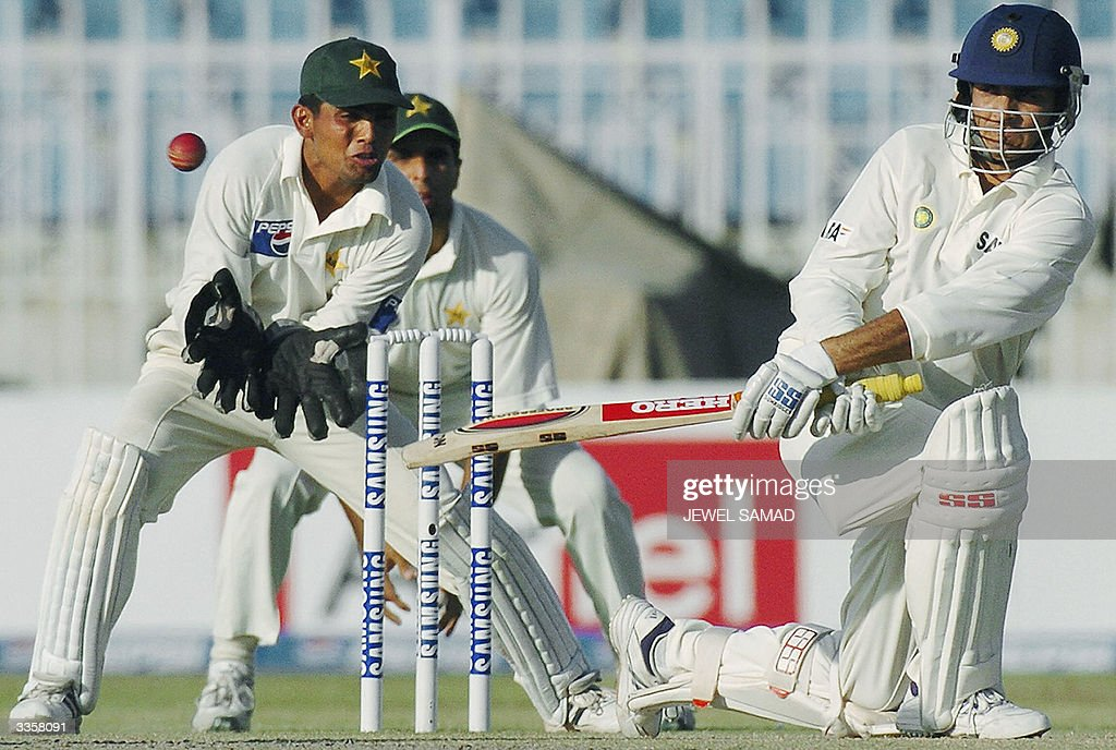 Indian captain Sourav Ganguly sweeps a ball off Pakistani spin