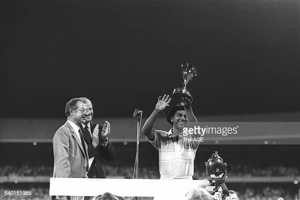 Indian Captain Sunil Gavaskar holds up the trophy after winning the Benson & Hedges World Championship of Cricket, 1984/85, final between India and...