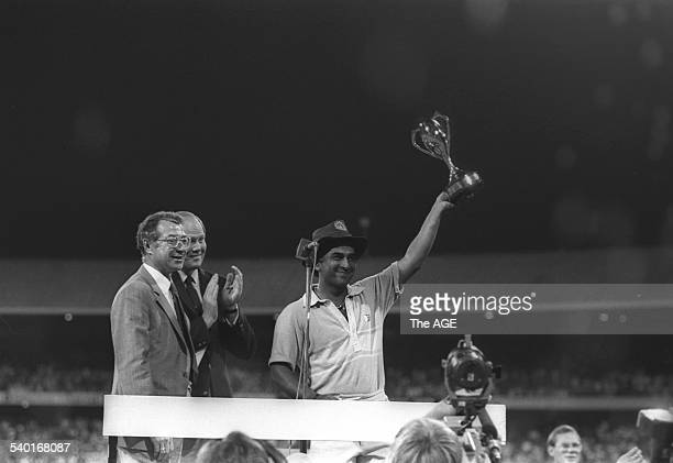 Indian Captain Sunil Gavaskar holds up the trophy after winning the Benson Hedges World Championship of Cricket 1984/85 final between India and...