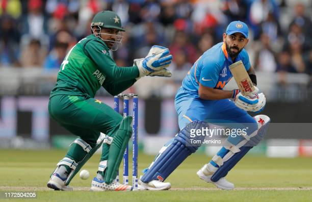 Indian captain Virat Kholi steers a ball past Pakistan captain Sarfaraz Ahmed during the India v Pakistan ICC Cricket World Cup match at Old Trafford...