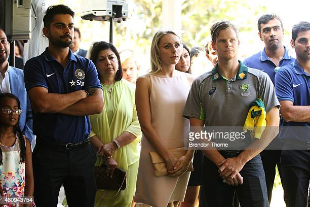 Indian captain Virat Kohli and Australian captain Steve Smith and his partner Danielle Willis look on during the Australian and Indian cricket team...