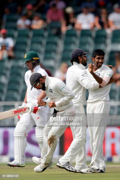 Indian Captain Virat Kohli and bowler Jasprit Bumrah celebrate the dismissal of South African batsman Ab de Villiers during the fourth day of the...