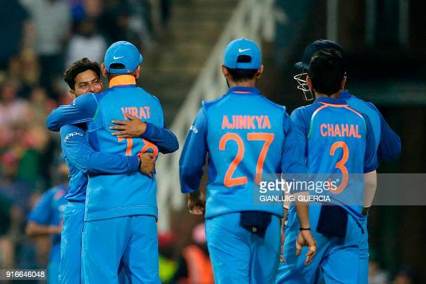 Indian Captain Virat Kohli and bowler Kuldeep Yadav celebrate the dismissal of South African batsman JP Duminy during the fourth One Day...