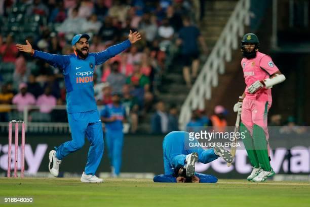 Indian Captain Virat Kohli and bowler Kuldeep Yadav celebrate the dismissal of South African batsman JP Duminy during the fourth One Day...