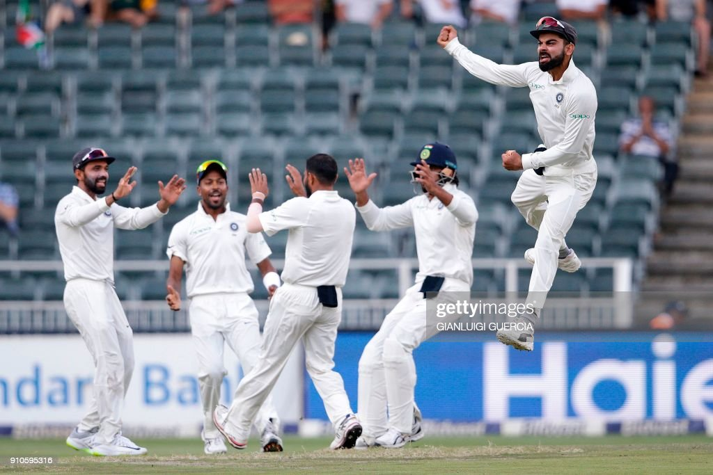 TOPSHOT - Indian Captain Virat Kohli (R) and bowler Mohammed Shami (3R) celebrate the dismissal of South African batsman Aiden Markram (not in picture) during the third day of the third test match between South Africa and India at Wanderers cricket ground on January 26, 2018 in Johannesburg. /