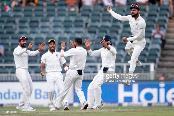 TOPSHOT Indian Captain Virat Kohli and bowler Mohammed Shami celebrate the dismissal of South African batsman Aiden Markram during the third day of...