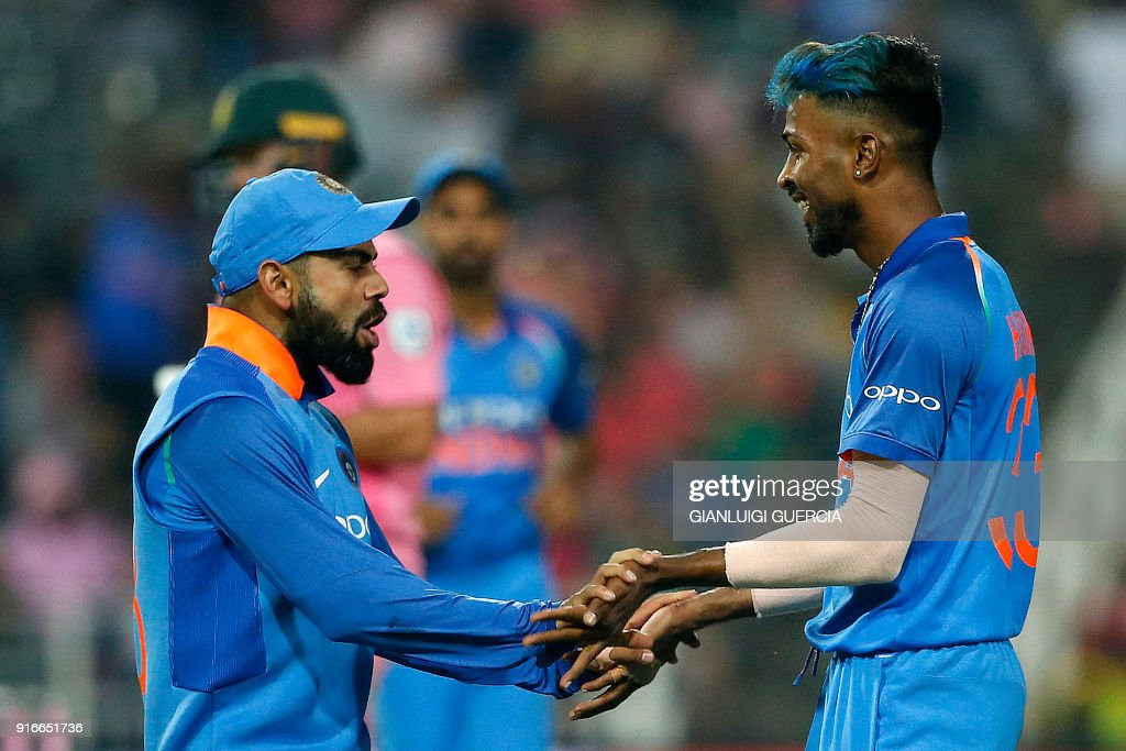Indian Captain Virat Kohli (L) and Indian bowler Hardik Pandya (R) celebrate the dismissal of South African batsman AB de Villiers (not pictured) during the fourth One Day International cricket match between South Africa and India at Wanderers cricket ground on February 10, 2018 in Johannesburg, South Africa. /