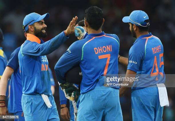 Indian captain Virat Kohli celebrates with his teammates after he dismissed Sri Lankan cricketer Angelo Mathews during the final one day...