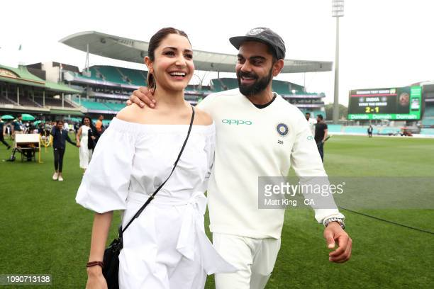 Indian captain Virat Kohli celebrates with his wife Anushka Sharma after winning the series and the Border–Gavaskar Trophy during day five of the...