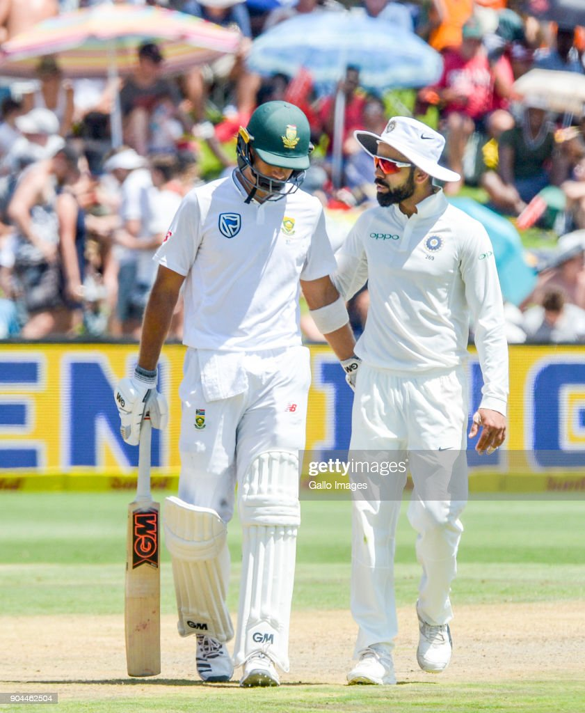 Indian captain Virat Kohli consoles Aiden Markram of South Africa as the umpire signals his dismissal after 94 runs during day 1 of the 2nd Sunfoil Test match between South Africa and India at SuperSport Park on January 13, 2018 in Pretoria, South Africa.