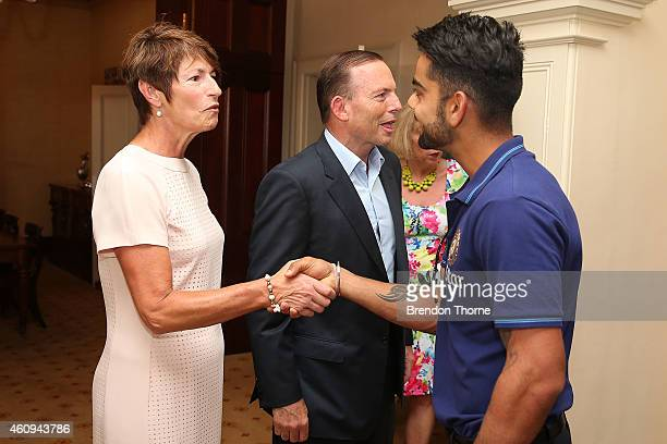 Indian captain Virat Kohli meets with Australian Prime Minister Tony Abbott and his wife Margaret Abbott during the Australian and Indian cricket...