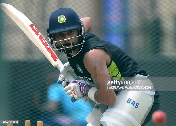 Indian captain Virat Kohli plays a shot during a practice session at the P Sara Oval Cricket Stadium in Colombo on August 18 ahead of the second Test...