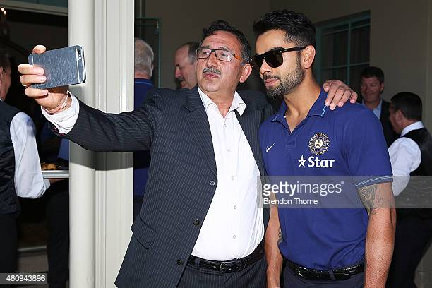 Indian captain Virat Kohli poses for a 'selfie' during the Australian and Indian cricket team visit at Kirribilli House on January 1 2015 in Sydney...