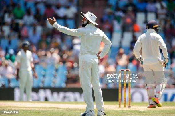 Indian Captain Virat Kohli reacts to a missed catch during the second day of the second Test cricket match between South Africa and India at...