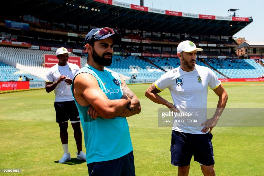 Indian Captain Virat Kohli (C), South African Captain Faf du Plessis, and bowler Lungi Ngidi (L) wait on the side for their post match interview after South African team won the second test match and the series against India during the fifth day of the second test cricket match between South Africa and India at the Supersport cricket ground, on January 17, 2018, in Centurion. /