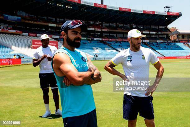 Indian Captain Virat Kohli South African Captain Faf du Plessis and bowler Lungi Ngidi wait on the side for their post match interview after South...