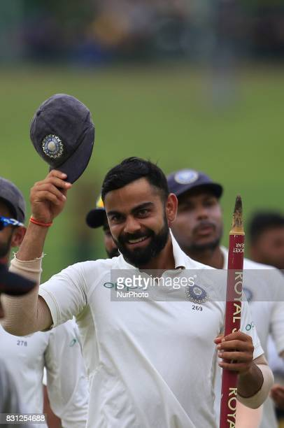 Indian captain Virat Kohli walks back to pavilion after winning the Test series 30 after the 3rd Day's play in the 3rd and final Test match between...