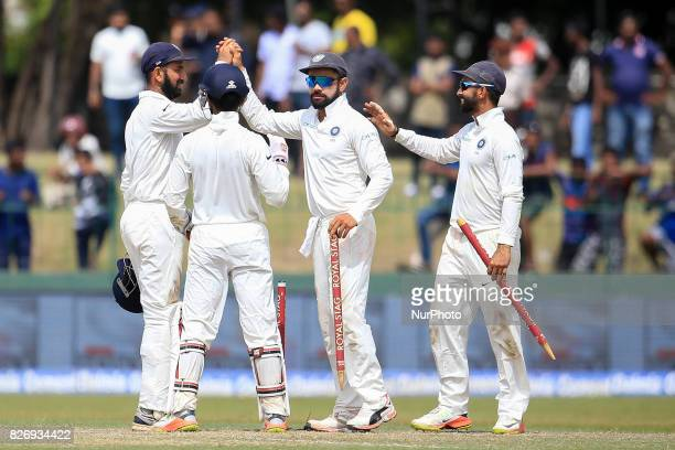 Indian captain Virat Kohli walks off with a stump in his hand after India defeated Sri Lanka by an innings and 53 runs during the 4th Day's play in...