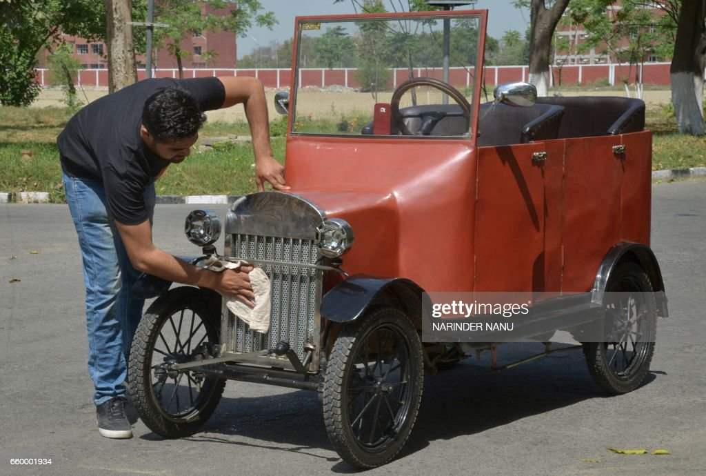 Indian car enthusiast Kiranjot Singh Bhullar cleans a car assembled using a range of TFord1925 model parts and run on a batteryoperated engine in...