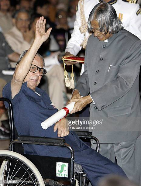 Indian cartoonist R K Laxman receives a Padma Vibhushan award from Indian President Abdul Kalam at the Presidential Palace in New Delhi 28 March 2005...